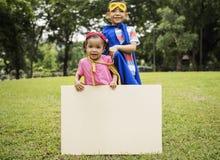 Concept espiègle de l'espace de copie de plaquette d'enfant de super héros Image libre de droits