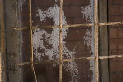 Lattice on the window built-up with bricks, the concept of eternal, life imprisonment. Concept of eternal, life imprisonment Royalty Free Stock Photo