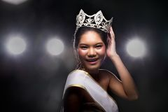 Concept every Girl Dream to Miss beauty Universe. Contest. Rural unique Bone Jawline Woman warships wear Diamond Silver Crown as Final want in Life, studio royalty free stock photos