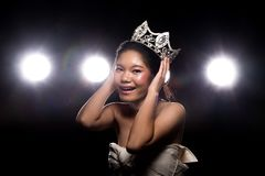 Concept every Girl Dream to Miss beauty Universe. Contest. Rural unique Bone Jawline Woman warships wear Diamond Silver Crown as Final want in Life, studio royalty free stock photo