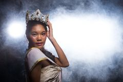Concept every Girl Dream to Miss beauty Universe. Contest. Rural unique Bone Jawline Woman warships wear Diamond Silver Crown as Final want in Life, studio stock image