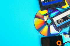 The concept of the evolution of music. Cassette, CD-disk, mp3 player. Vintage and modernity. Music support. The concept of the evolution of music. Cassette, CD stock photos