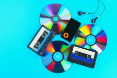 The concept of the evolution of music. Cassette, CD-disk, mp3 player. Vintage and modernity. Music support. The concept of the evolution of music. Cassette, CD stock photography
