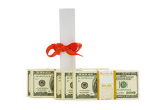 Concept of expensive education. Dollars and diploma Royalty Free Stock Images
