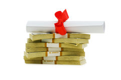 Concept of expensive education. Dollars and diploma Stock Image