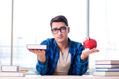 The concept of expensive textbooks and cost of education. Concept of expensive textbooks and cost of education Stock Image
