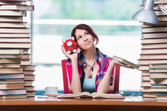 The concept of expensive textbooks with female student Stock Images