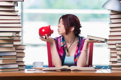 The concept of expensive textbooks with female student Stock Photo