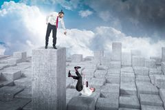 Concept of failure. Concept of business failure men on top and falling businessman stock photo