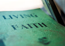 Concept of Faith on Paperback Book Cover Stock Photo