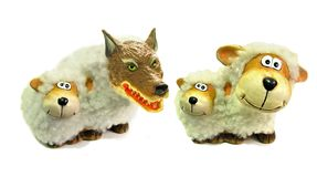 Wolf in disguise as sheep fake false friends scam intruder. Concept of fake false friends with wolf wearing sheep disguise in group of other sheep stock photography