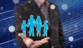 Concept of family. Family concept above the hand of a man in background stock photography