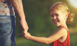 Concept of family. child girl holding hand of dad Royalty Free Stock Images