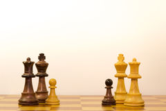 Concept of a family with different ethnicity. With pawns of chess Stock Images