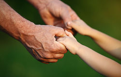 Concept of family. Hand the child's in hand  father Stock Photo