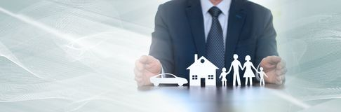 Concept of family, home and car insurance. panoramic banner. Insurer protecting a family, a house and a car with his hands. panoramic banner royalty free stock photography