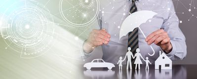 Concept of family, home and car protection; light effect. General agent protecting a family, a house and a car; light effect stock photography