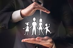 Concept For Family Insurance with Businessman on Dark stock images