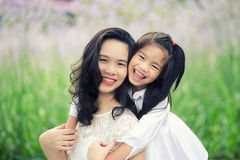 Concept of family. mother and child daughter outdoors in summer.  stock images