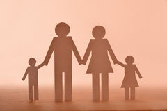 Concept family in paper on wood Royalty Free Stock Image