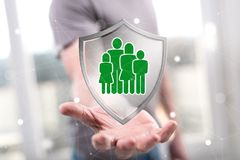 Concept of family protection. Family protection concept above the hand of a man in background stock photos