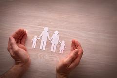 Concept of family protection with hands around protecting them s Royalty Free Stock Images