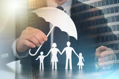 Concept of family protection; multiple exposure stock photo