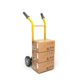 Concept of fast delivery boxes. On a yellow trolley Royalty Free Stock Image