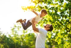 Concept of father`s day! happy family dad and child daughter    in nature royalty free stock images
