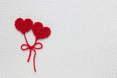 The concept for 14 February, romantic Valentine day. Love affair, love story. Red crochet wool heart and ribbon on white crochet. Background. Festive overhead stock images