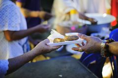Concept of feeding : Sharing food with people in poor communities : the concept of sharing help to fellow human beings in society.  royalty free stock photos