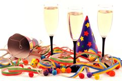 Glasses of champagne and party favors on a white background royalty free stock photo