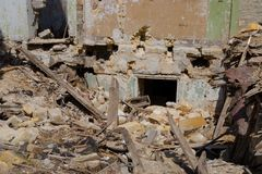 Abandoned and devastated building in Ukraine, Donbass. Concept of the fighting force and war. Abandoned and devastated building in Ukraine, Donbass Royalty Free Stock Images