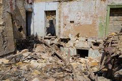 Concept of the fighting force and war. Ruins of house, war. Abandoned and devastated building in Ukraine, Donbass Royalty Free Stock Photography