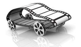 Concept of film industry. One car made with four film reels as wheels and a film strip, concept of film industry or action movie, but also fast movie streaming ( Royalty Free Stock Image