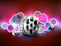 Concept of film reel. Film reel on abstract shiny background stock illustration