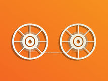 Concept of film reels. Film reels on orange background Stock Photos