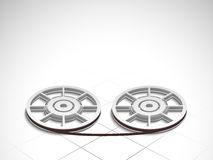 Concept of film reels. Film reels on stylish shiny light grey background Royalty Free Stock Image