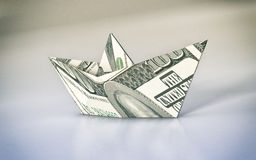 Concept of finance. Close-up view of a paper boat made with dollar banknotes, concept of business and finance (3d render Stock Photos