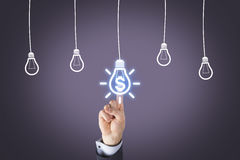 Concept of finance and innovation with light bulb on screen stock photo