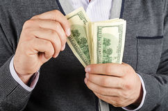 Concept of finance success. Businessman holding Cash Dollars in hands. Concept of finance success Stock Image