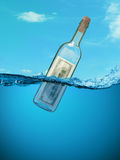 Concept. Financial assistance. Bottle of money floating in the water. Money in a wine bottle as a  by desperate Stock Photo