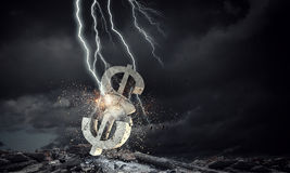 Concept of financial crisis. Mixed media. Lightning striking stone dollar sign. Mixed media Stock Images