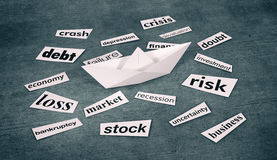 Concept of financial crisis. Top view of a paper boat with scraps of paper and words about financial crisis, grunge background (3d render Royalty Free Stock Photos