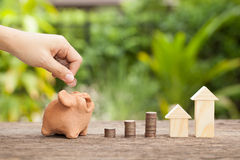 The concept of financial savings to buy a house. Royalty Free Stock Images