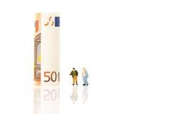 Concept financier d'affaire, rouleau d'euro factures de papier d'argent et homme d'affaires Photo libre de droits