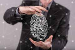 Concept of fingerprint security system. Fingerprint security system concept between hands of a man in background Stock Photos