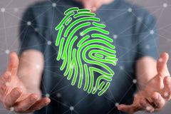 Concept of fingerprint security system. Fingerprint security system concept between hands of a man in background Royalty Free Stock Photography
