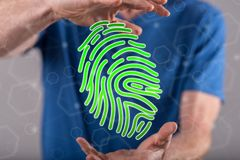 Concept of fingerprint security system. Fingerprint security system concept between hands of a man in background Royalty Free Stock Image
