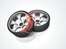 Concept of fire with car wheels. Shiny car wheels with fire flames on floor background Stock Photos